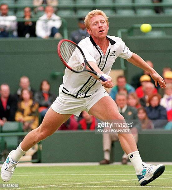 German Boris Becker chases the ball 30 June in his match against Britain's Mark Petchey at the Wimbledon Championships