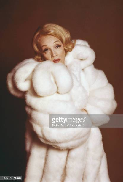 German born American actress Marlene Dietrich pictured wearing a fur coat during a promotional tour for her television special, 'An Evening with...
