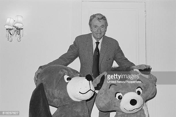 German born animator Wolfgang Reitherman posed with two characters from the film The Fox and the Hound in London on 30th November 1981