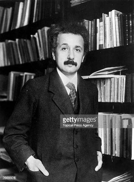 German born mathematical atomic physicist Albert Einstein .