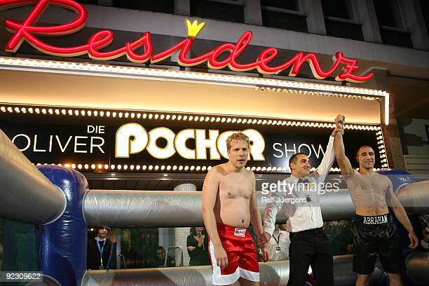 German boxer Arthur Abraham celebrates after winning a fight against German entertainer Oliver Pocher during a taping for 'Die Oliver Pocher Show'...