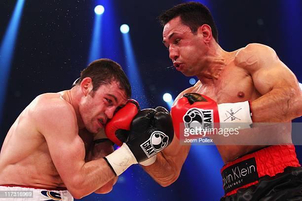 German boxer Felix Sturm hits challenger Matthew Macklin of the Ireland during their WBA Super World middleweight title fight at Lanxess Arena on...
