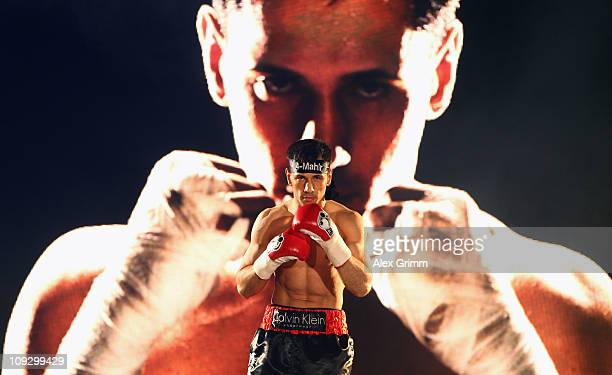 German boxer Felix Sturm walks into the arena for his WBA middleweight title fight against challenger Ronald Hearns of the US at PorscheArena on...