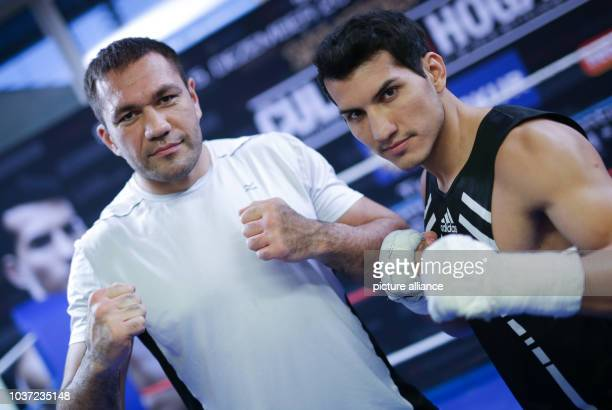 German boxer Jack Culcay and Bulgarian boxer Kubrat Pulev pose during a media training session at the Dockland building inHamburg Germany 01...