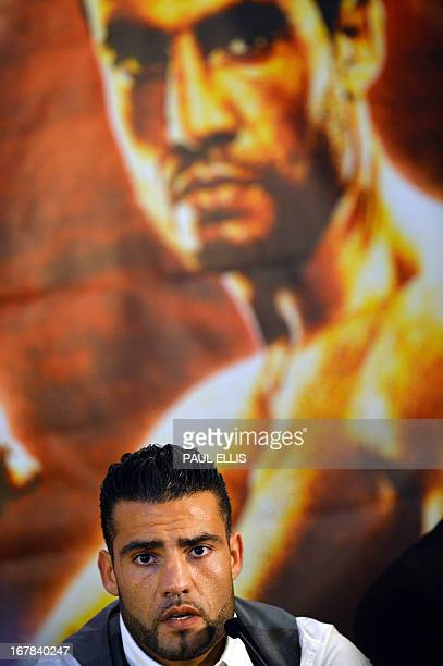 German boxer Manuel Charr speaks during a press conference in Manchester England on May 01 to promote his upcoming heavyweight fight against British...