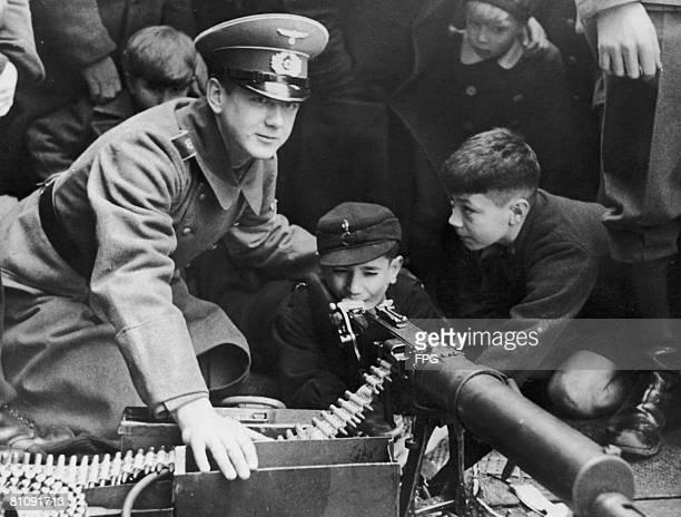 German boys are shown how to fire a machine gun, circa 1935.