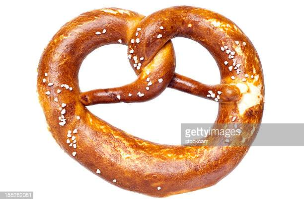 german bread pretzel on a white background - bun bread stock pictures, royalty-free photos & images