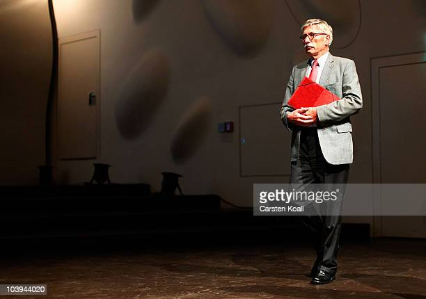 German Bundesbank board member Thilo Sarrazin arrives to read from his new book 'Deutschland Schafft Sich Ab' at Nikolai Hall on September 9 2010 in...