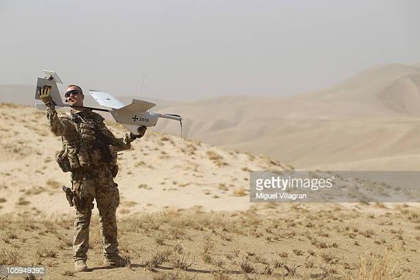A German Bundeswehr holds an EMT Aladin airborne reconnaissance drone for close area imaging during a regular patrol on October 17 2010 near...