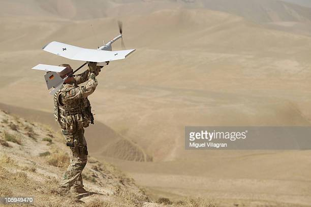 A German Bundeswehr launches an EMT Aladin airborne reconnaissance drone for close area imaging during a regular patrol on October 17 2010 near...