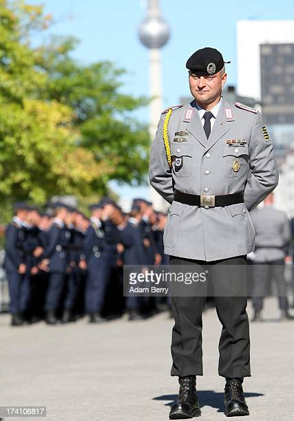 German Bundeswehr officer waits for the start of a swearingin ceremony for new recruits of the Bundeswehr the armed forces of the Federal Republic of...