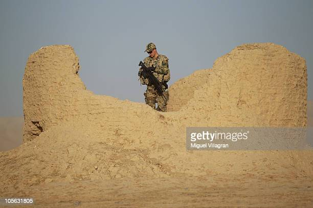 A German Bundeswehr patrols high ground and searches for improvised explosive devices during a regular patrol on October 17 2010 near MazareSharif...