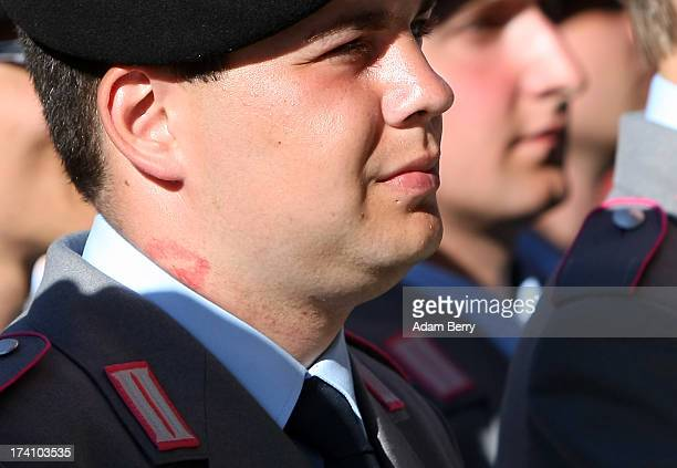 German Bundeswehr recruit with lipstick marks on his neck waits for the start of a swearingin ceremony of the Bundeswehr the armed forces of the...