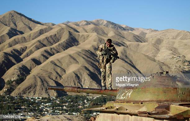 German Bundeswehr soldier balances on the wreck of a former Russian tank on October 1 2010 in Feyzabad Afghanistan Germany has more than 4500...