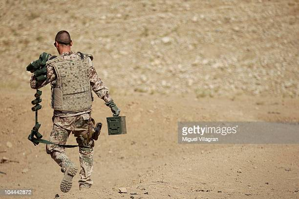 German Bundeswehr soldier brings old ammunition to a collecting point near Camp Marmal on September 25 2010 in MazareSharif Afghanistan Old...