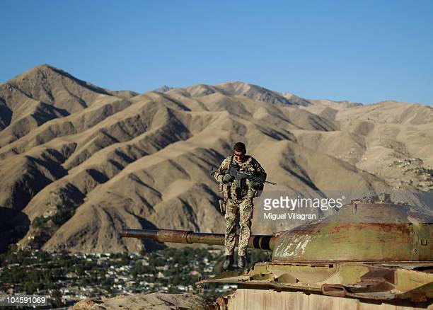 German Bundeswehr soldier jumps off the wreck of a former Russian tank on October 1 2010 in Feyzabad Afghanistan Germany has more than 4500 military...