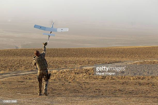 A German Bundeswehr soldier launches an EMT Aladin airborne reconnaissance drone for close area imaging during a regular patrol on October 17 2010...