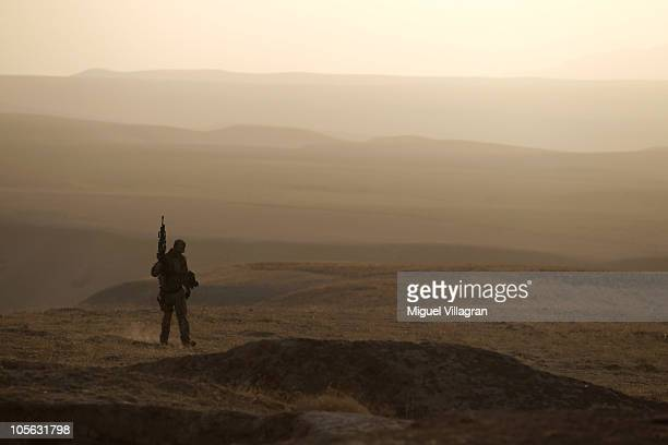 A German Bundeswehr soldier patrols high ground and searches for improvised explosive devices during a regular patrol on October 17 2010 near...