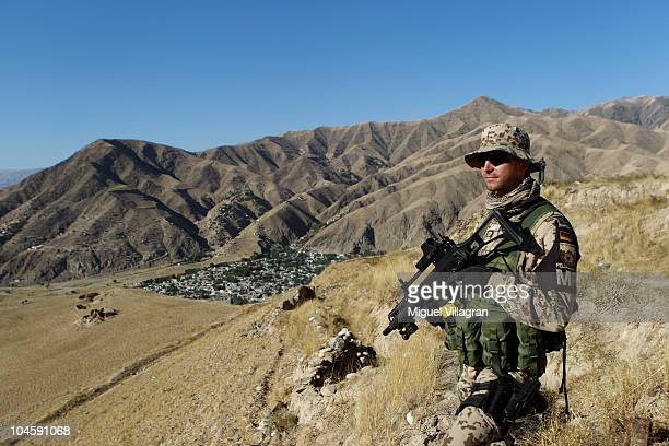 German Bundeswehr soldier patrols high ground overlooking the city on October 1 2010 in Feyzabad Afghanistan Germany has more than 4500 military...