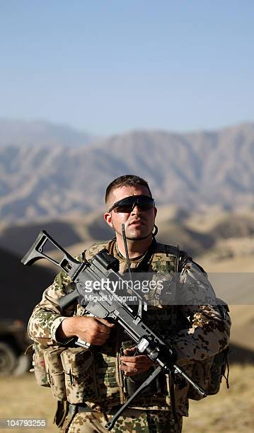 German Bundeswehr soldier patrols high ground overlooking the city on October 5 2010 in Feyzabad Afghanistan Germany has more than 4500 military...