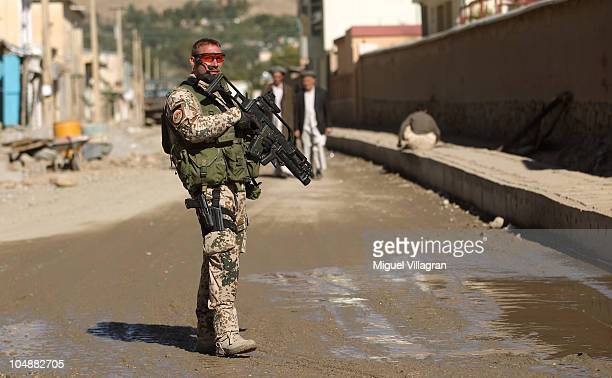 German Bundeswehr soldier secures the entrance of the Afghan German development cooperation during a regular patrol on October 1 2010 in Feyzabad...