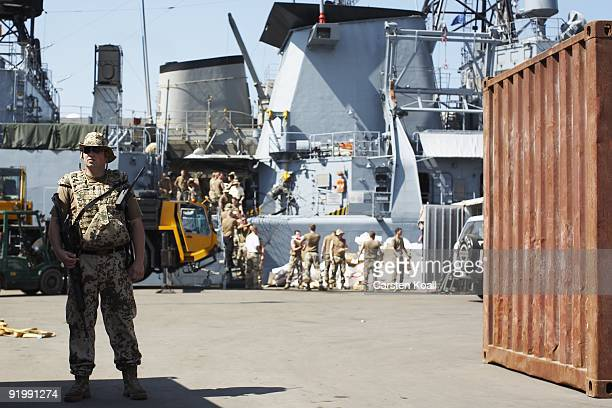 A german Bundeswehr soldier secures the entrance to the quay of the frigate Karlsruhe in the Port of Djibouti on December 16 2008 in Djibouti The...