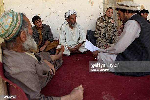 A German Bundeswehr soldier talks to the natives of a small village on October 17 2010 near MazareSharif Afghanistan Germany has more than 4500...