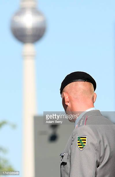 German Bundeswehr soldier waits for the start of a swearingin ceremony for new recruits of the Bundeswehr the armed forces of the Federal Republic of...