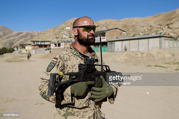 German Bundeswehr soldier walks through a street during a patrol on October 2 2010 in Feyzabad Afghanistan Germany has more than 4500 military forces...