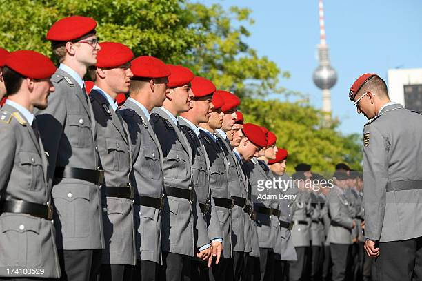 German Bundeswehr soldiers are reviewed prior to the start of a swearingin ceremony for new recruits of the Bundeswehr the armed forces of the...