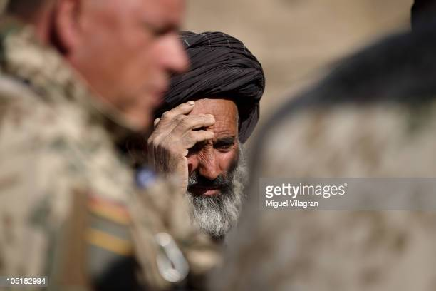 German Bundeswehr soldiers of a CIMIC unit talk to the inhabiters of the village on October 11 2010 in Narwan Afghanistan Germany has more than 4500...