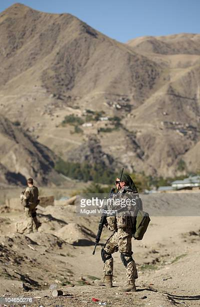German Bundeswehr soldiers patrol a street on October 2 2010 in Feyzabad Afghanistan Germany has more than 4500 military forces in Afghanistan as...