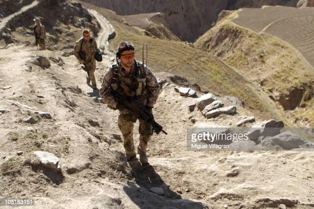 German Bundeswehr soldiers patrol high ground during a regular patrol on October 11 2010 in Narwan Afghanistan Germany has more than 4500 military...