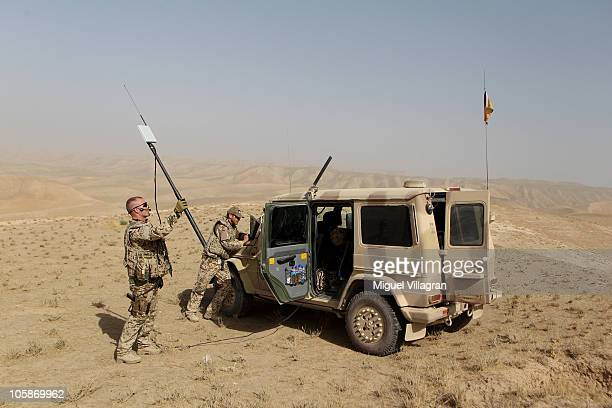 German Bundeswehr soldiers remote control an EMT Aladin airborne reconnaissance drone for close area imaging during a regular patrol on October 17...