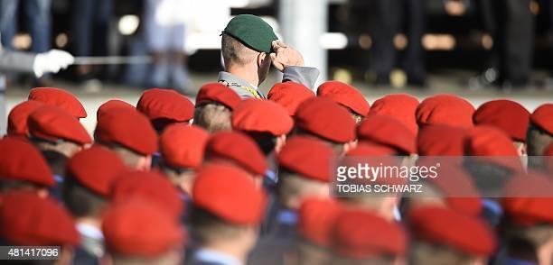 German Bundeswehr soldiers salute during swearingin ceremony of German Bundeswehr soldiers at the Bendlerblock in Berlin on July 20 2015 AFP PHOTO /...