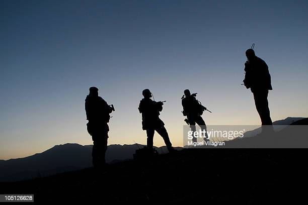 German Bundeswehr soldiers stand guard at an observation point during a regular night patrol on October 10 2010 in Feyzabad Afghanistan Germany has...