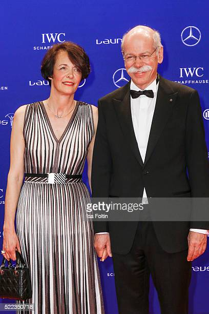 German businessman and the Chairman of the Board of Directors of Daimler AG Dieter Zetsche and his partner Anne attend the Laureus World Sports...