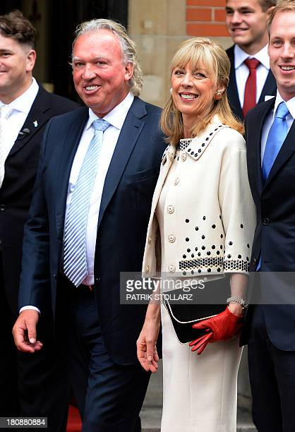 German businessman Hartmut Lademacher and his wife Gabriele LademacherSchneider smile upon arrival at the Civil Wedding Ceremony of their daughter on...