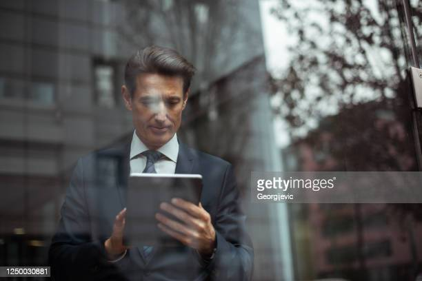 german businessman - infront the window - georgijevic frankfurt stock pictures, royalty-free photos & images