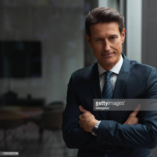 german businessman - looking through window - georgijevic frankfurt stock pictures, royalty-free photos & images