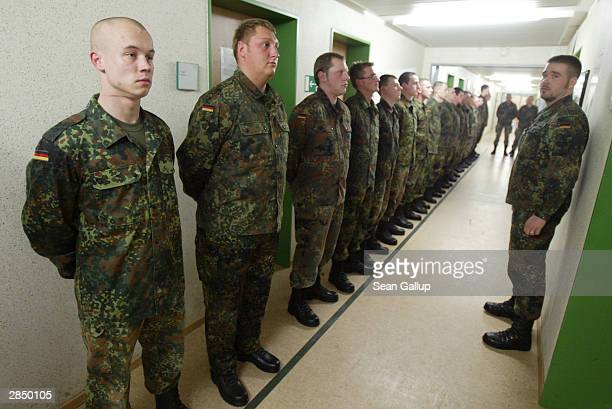 German cadets line up for an inspection January 7, 2004 on the third day of their nine-month national military service in Marienberg, Germany....