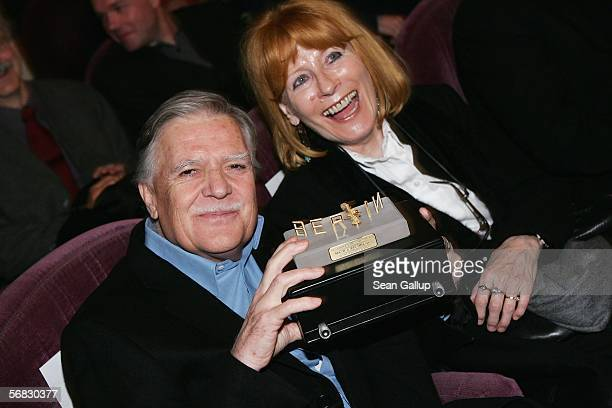 German cameraman Michael Ballhaus holds his Berlinale Camera Award with his wife Helga at the Berlinale Berlin's international film festival February...