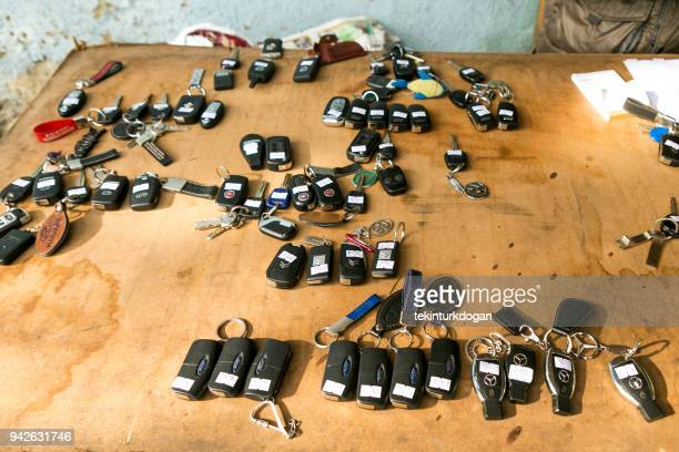 german car keys at parking valet desk at istanbul turkey - valet stock photos and pictures