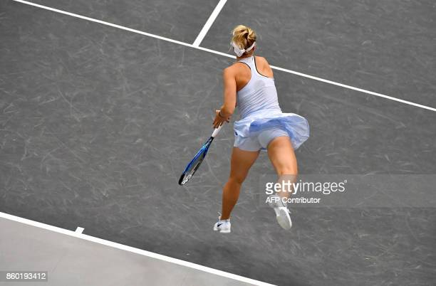 German Carina Witthoeft returns to Austrian Barbara Haas during the WTA Ladies tennis match in Linz, Upper Austria, on October 11, 2017. / AFP PHOTO...