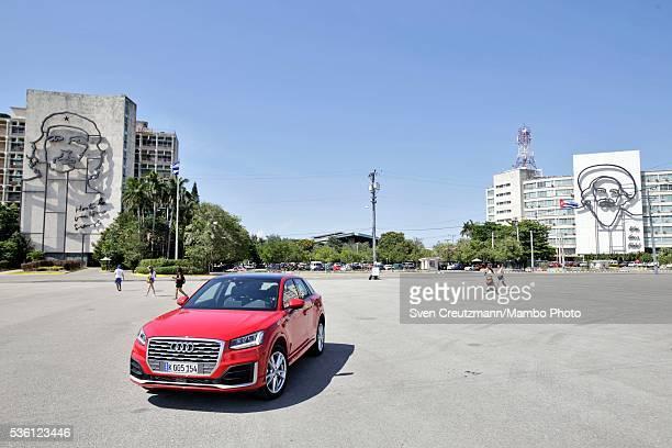 Q2 German carmaker Audis latest model stands under the images of Cuban Revolution heroes Che Guevara and Camilo Cienfuegos at the Plaza de la...