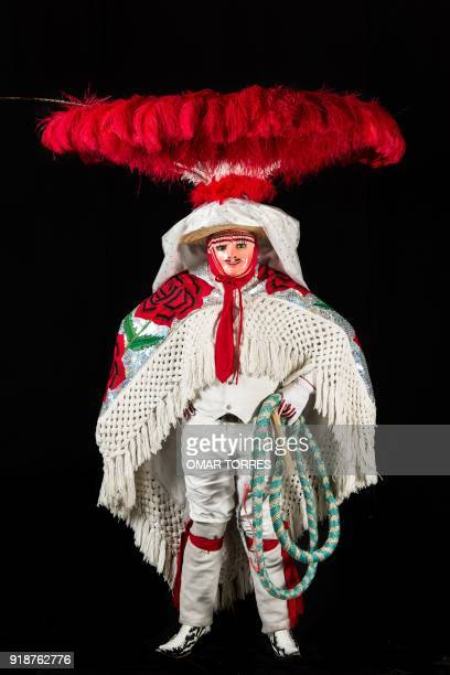German Carrillo poses in his Charro costume for the carnival in Tlaxcala Mexico on February 13 2018 The satirical costumes and masks were originally...