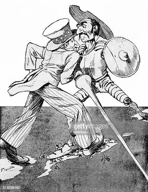 German cartoon from April 1898. Uncle Sam and Don Quixote, who represents Spain, face off while stepping on the island of Cuba.