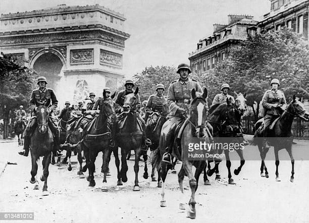 German cavalry soldiers ride through Paris in 1940 after occupying the city