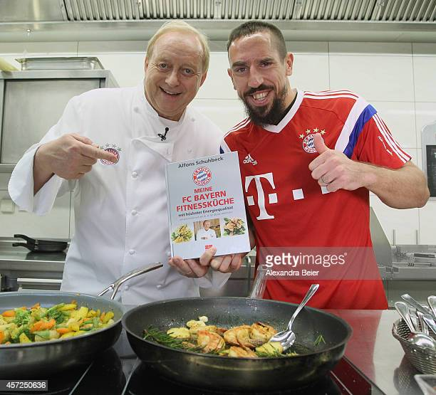 German celebrity chef Alfons Schuhbeck and FC Bayern Muenchen player Franck Ribery unveil a new FC Bayern cookbook on October 15 2014 in Munich...