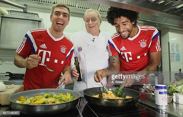 German celebrity chef Alfons Schuhbeck and FC Bayern Muenchen players Philipp Lahm and Dante unveil a new FC Bayern cookbook on October 15 2014 in...